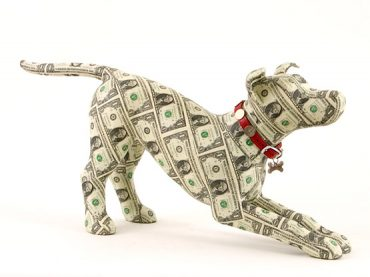 Washington, a money covered dog sculpture by Justine Smith, London